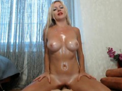 Busty blonde babe oils her whole body including her nice