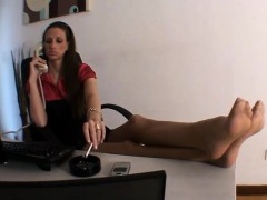Smoking And Showing Off Her Feet In An Office