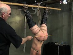 Hanged upside down slave caned