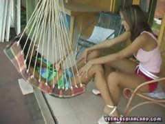 Babes kissing and touching their tits outdoor