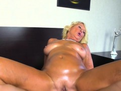 Rich granny gets an oily fucking