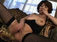 Asian mature in lingerie poses then sits on the couch to ru