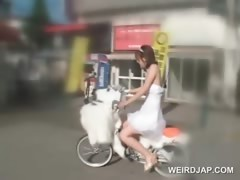 Asian teen doll getting pussy wet while riding the bike