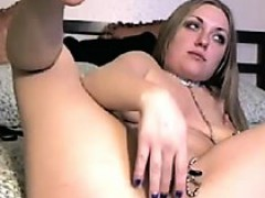 Cute blonde fingers and toys her pussy