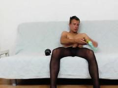 Horny gay boy Josh stroking his cock in panty-hose