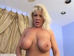 Big-breasted blonde MILF enjoys pumping this young hunk's s