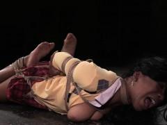 Hogtied ebony schoolgirl stimulated with toys