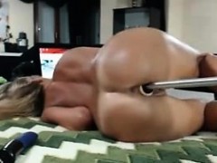 Blonde chating with a dildo in pussy