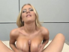 Busty beauty tugging cock with her boobs