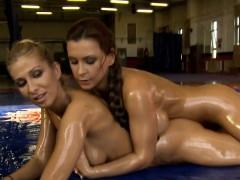 Oil wrestling busty lesbos seducing pussies