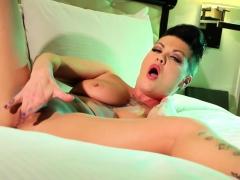 Brunette pornstar Jezebelle strips off her lingerie